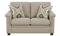 High-back loveseat with tapered wood feet in neutral linen upholstery with green and white throw pillows