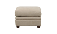 Pillow-top ottoman with tapered wood feet in neutral linen upholstery