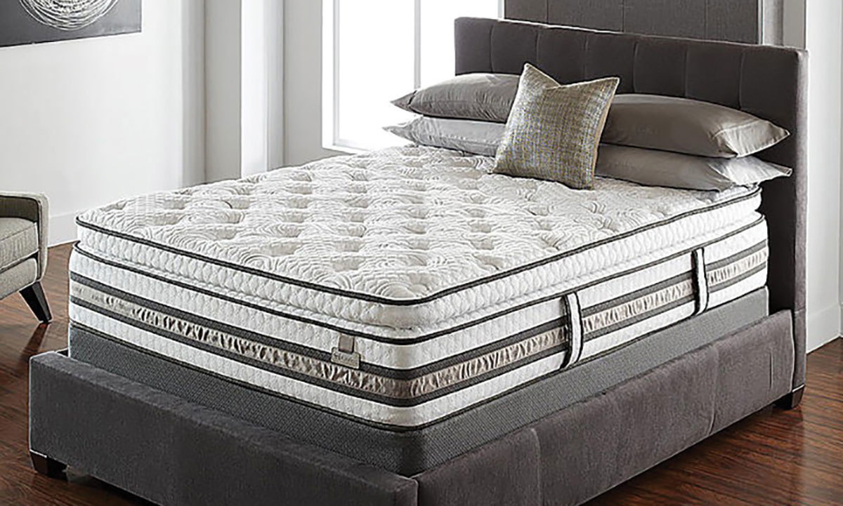 """Plush 15"""" pillowtop mattress with white and gray cover in bedroom"""