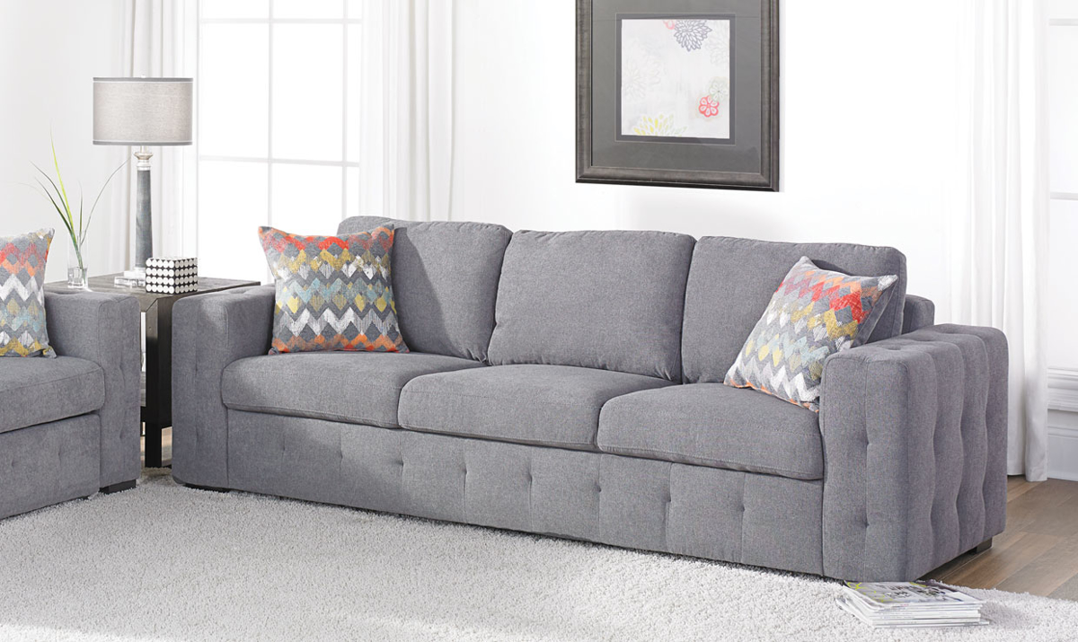 Tufted track arm sofa is upholstered in a contemporary grey fabric.