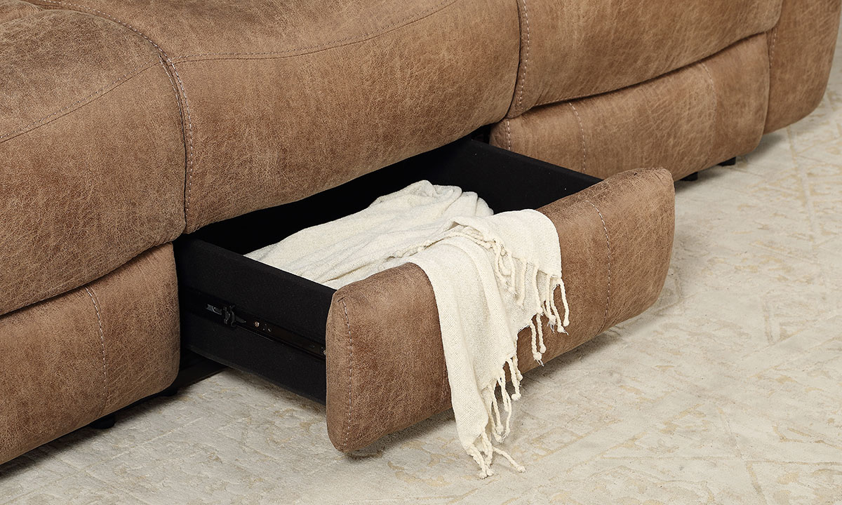 Close-up of hidden storage on 88-inch manual reclining sofa in brown upholstery