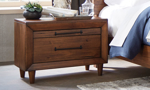 Modern 2-drawer nighstand with live edge crafted from Brazilian pinewood in warm brown finish in bedroom