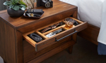 Close-up of top drawer organizer in 2-drawer nighstand with live edge in warm brown finish