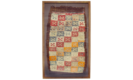 Framed antique handcrafted Turkish wool rug in red, yellow, blue and white checkerboard pattern with burgundy border.