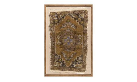 Framed antique Turkish wool rug in ochre, plum and rose tone hues with traditional medallion motif.