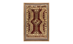 Framed antique Oushak Turkish rug with burgundy and tan talisman motif.