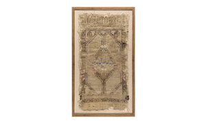 Framed distressed antique Turkish wool rug with diamond pattern in brown and tan natural tones.