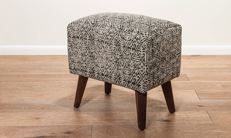 18-inch ottoman with floral diamond patterned upholstery with wood legs