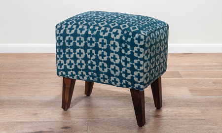 18-inch ottoman stool with indigo blue upholstery with a white pattern