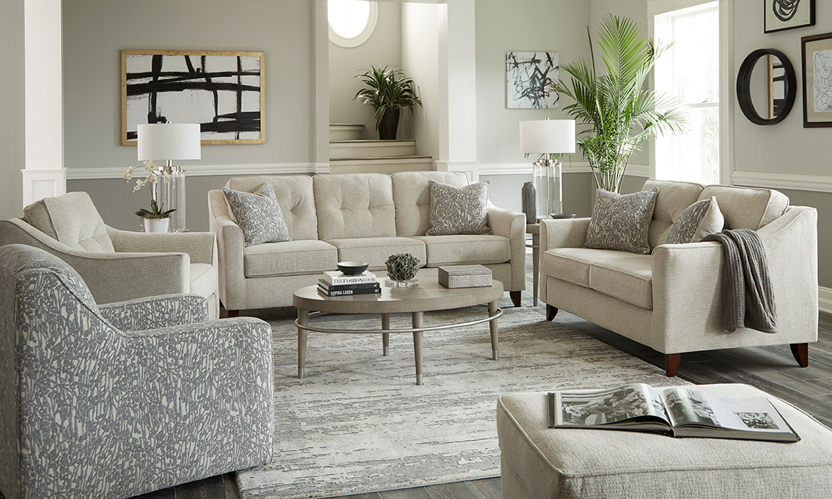 Three-piece living room set includes a cream-colored fabric sofa, loveseat and matching chair.