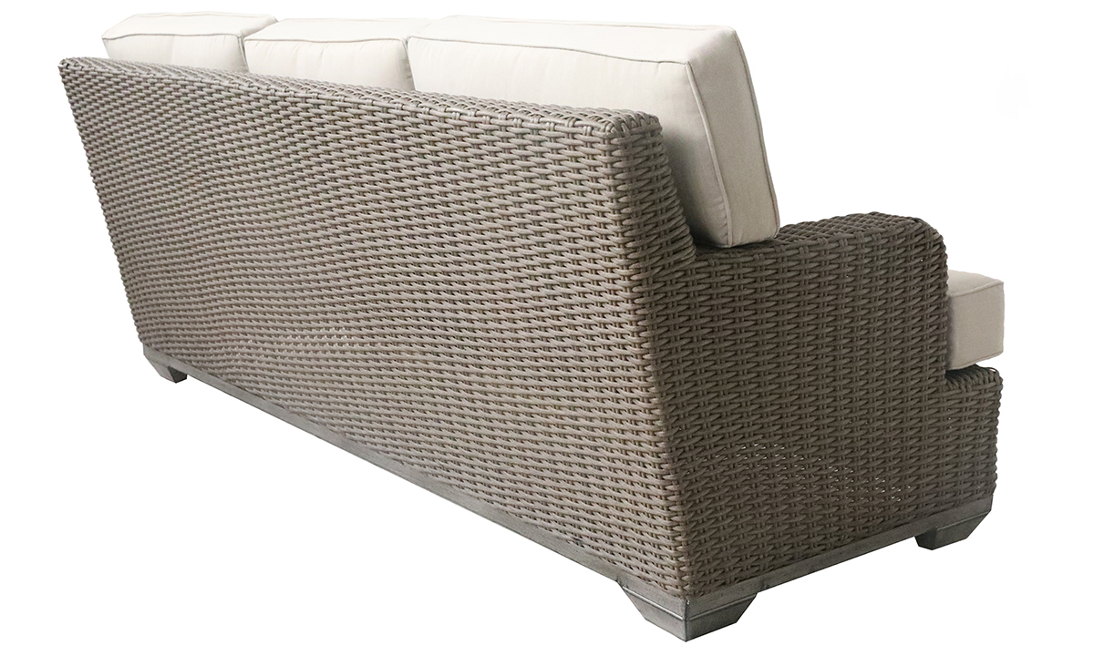 All-weather 85-inch outdoor sofa in brown resin wicker with neutral tone cushions - Back side view