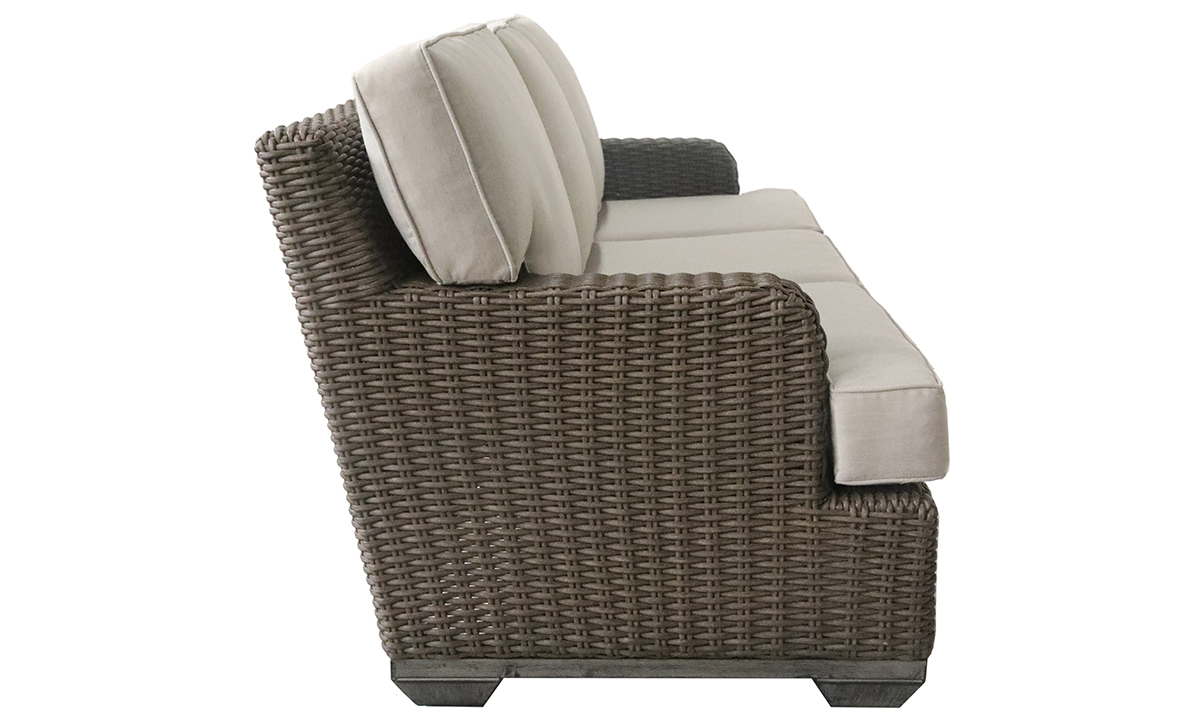 All-weather 85-inch outdoor sofa in brown resin wicker with neutral tone cushions - Side View