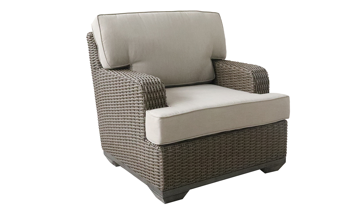 Deep-seated all-weather 35-inch club chair in brown resin wicker with neutral tone cushion