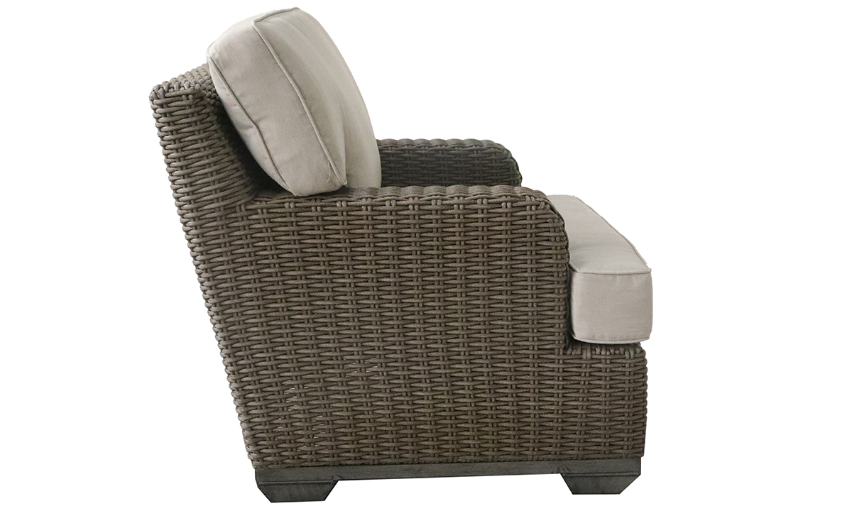 Deep-seated all-weather 35-inch club chair in brown resin wicker with neutral tone cushion - Side View