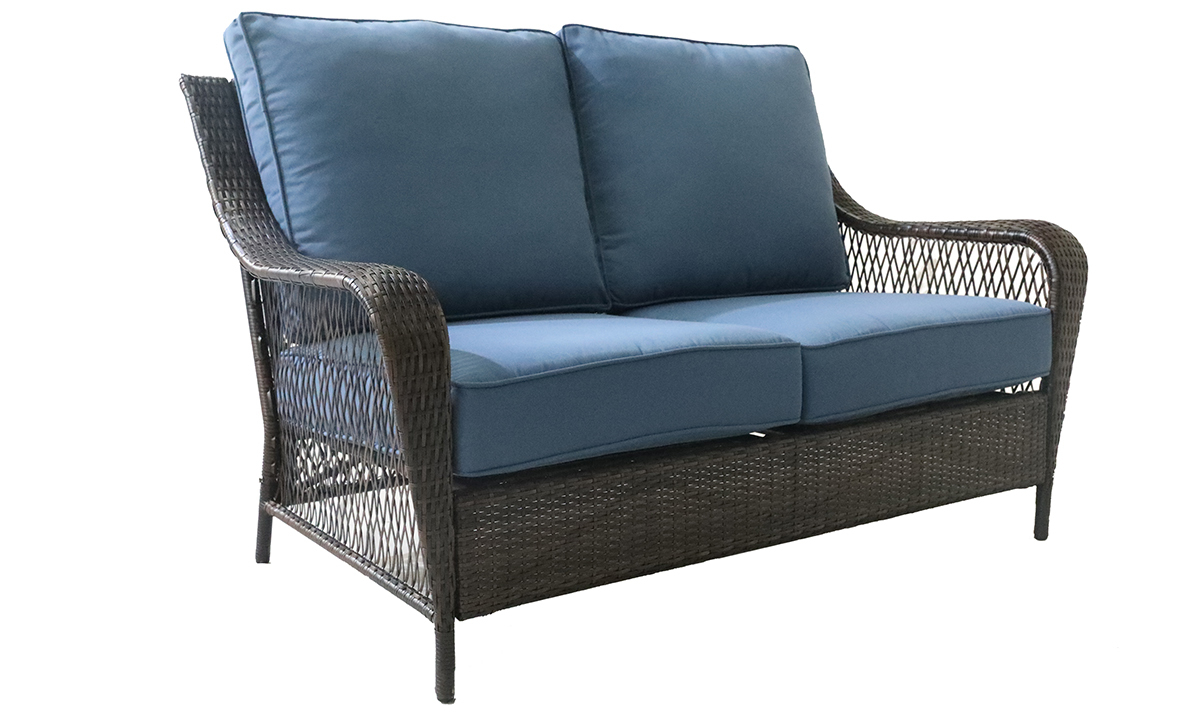 All weather 60-inch resin wicker loveseat with blue quick dry upholstery cushions - Angled Shot