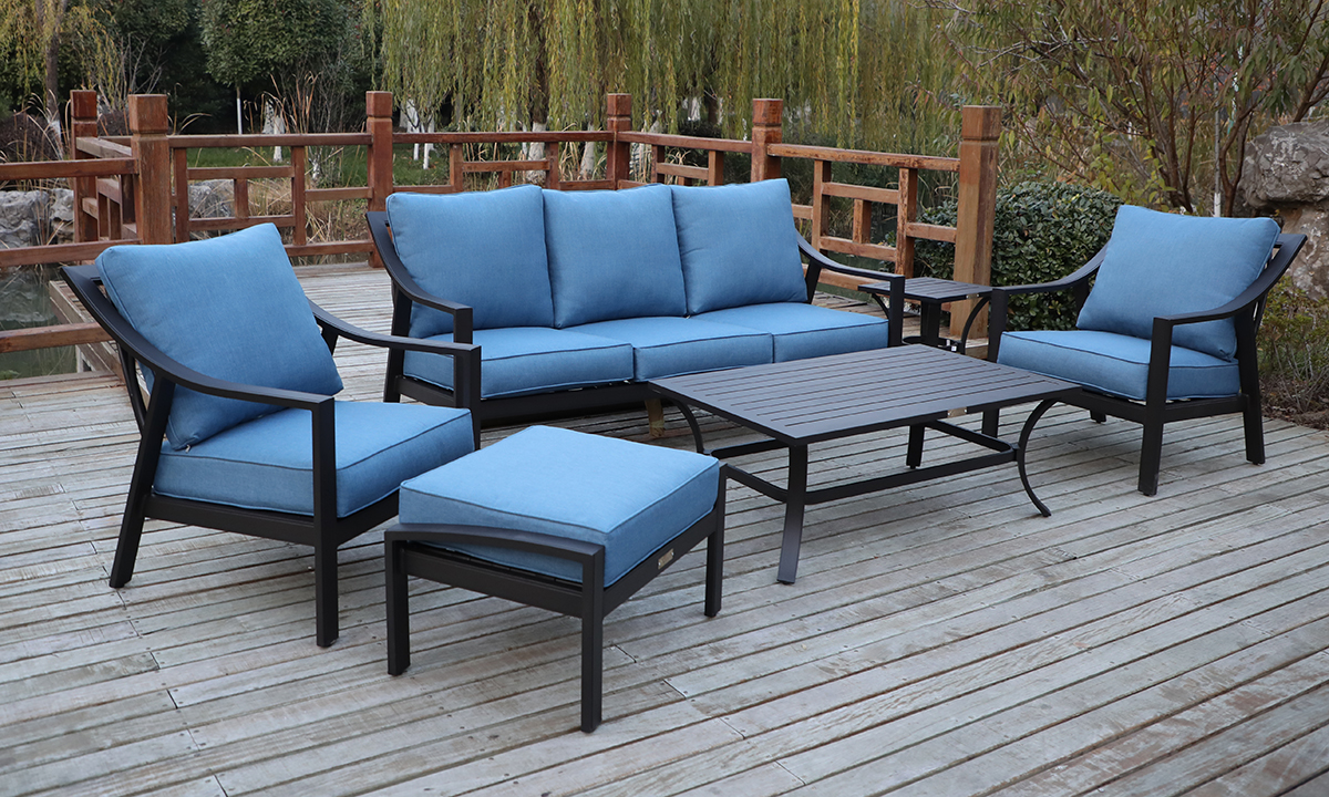 All-weather outdoor patio seating set with black aluminum frame and blue cushions on deck