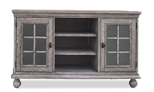 Transitional 60-inch entertainment console  with two glass paned cabinets and center open storage shelves in weathered gray wood finish