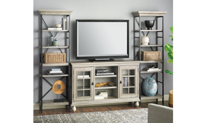 """3-piece contemporary entertainment unit with 60-inch wide console and two 79.5"""" tall storage shelves in weathered wood finish with TV and accessories."""