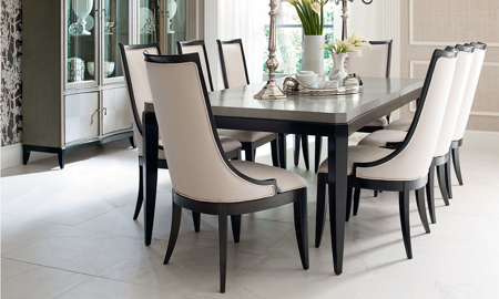 Elegant 7-piece dining set with 74-inch two-tone platinum and black table and 6 ivory fabric chairs in dining room.