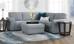 Grey fabric sleeper sectionals are available in two configurations and feature a pop-up sleeper.