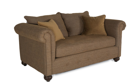 Roll-Arm Loveseat with Button Tufting across bottom Upholstered in Neutral Chutney Fabric with Accent Pillows