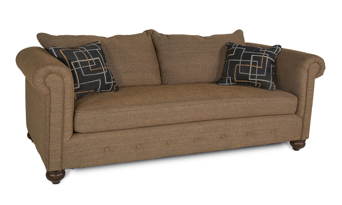 Roll-Arm Sofa with Button Tufting across the bottom in Neutral Chutney Fabric includes Two Accent Pillows