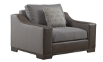 Wide arm chair in a mix of gray tweed fabric and brown leather atop dark wood feet with throw pillow