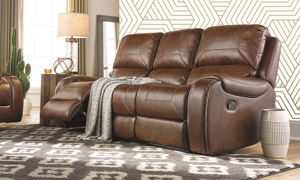 Stylish Caramel 3-piece reclining living room set in high grade fabric featuring a sofa, loveseat, & chair with built in storage console & cup holders.