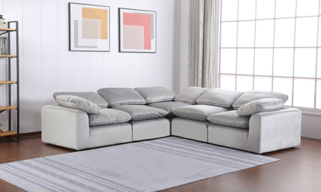 Contemporary 5-piece modular sectional sofa in soft grey velvet upholstery with plush feather down seat and back cushions