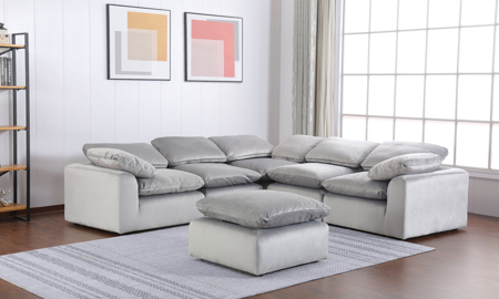 Contemporary 5-piece sectional sofa with ottoman in soft grey velvet upholstery with feather down back and seat cushions.