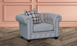 49-inch Chesterfield armchair in grey upholstery with button tufting and rolled arms - Angled View
