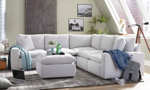 Lifestyle shot of the Roswell Horizon Corner Sectional and matching Ottoman.