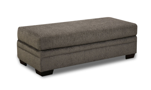 American-made rectangular storage ottoman with grey fabric upholstery.