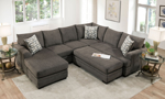 Lifestyle shot from above of the Croft Charcoal grey sectional and ottoman.