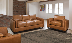 Modern armchair American-made with top grain leather in a warm butterscotch color.