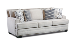 Fabric upholstered living room set including a sofa, loveseat and armchair with nailhead trim.