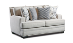 Off White loveseat couch with four coordinating throw pillows and classic nail head trim.