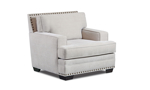 Timeless armchair in cream-colored fabric upholstery with nail head trim.