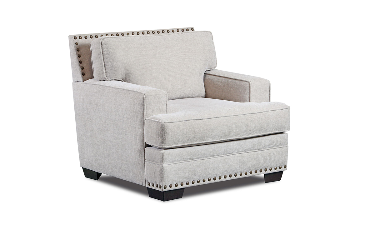 Cream-colored fabric upholstered arm chair with nail head trim.