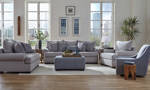 Living room scene of Lockwood Granite grey couch, loveseat, armchair, swivel chair and ottoman.
