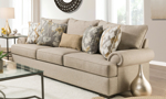 Traditional roll arm sofa in a beige wheat fabric with five coordinating throw pillows.