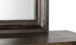 Distressed brown mirror from the Cooper Beach Bark Collection can decorate any room in your home.