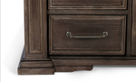 Chest featuring cron molding for a timeless look.