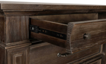 Coopers Beach Bark chest features crown molding for a classic look.