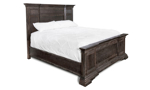 Queen or king size mansion panel bed in a distressed wood finish.