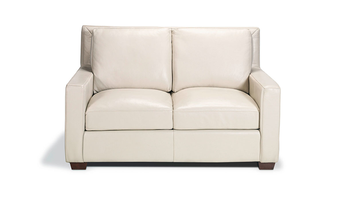 Top-grain leather loveseat from Rocky Mountain Leather in an off-white bone hue.