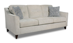Cream fabric upholstered sofa with matching throw pillows.
