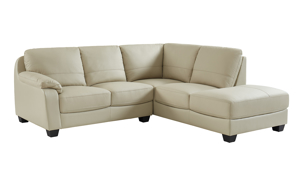 Top grain leather sectional with chaise in a neutral beige hue.