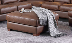 """37"""" wide leather ottoman from Niroflex Leather."""