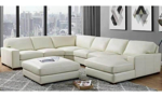 Bone white leather sectional and ottoman from Niroflex Leather.